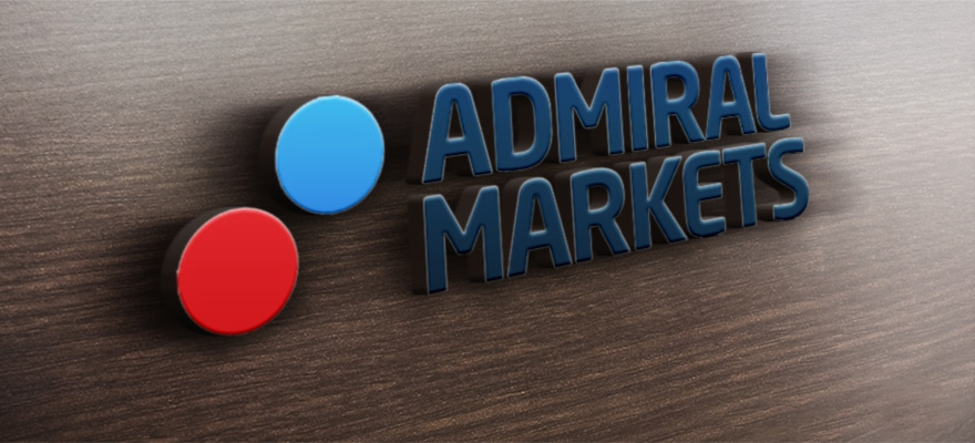 Admiral Markets logo on a wooden background