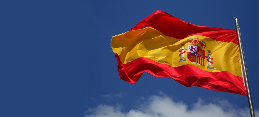 The flag of Spain against a blue sky