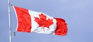 Flag of Canada against a blue sky