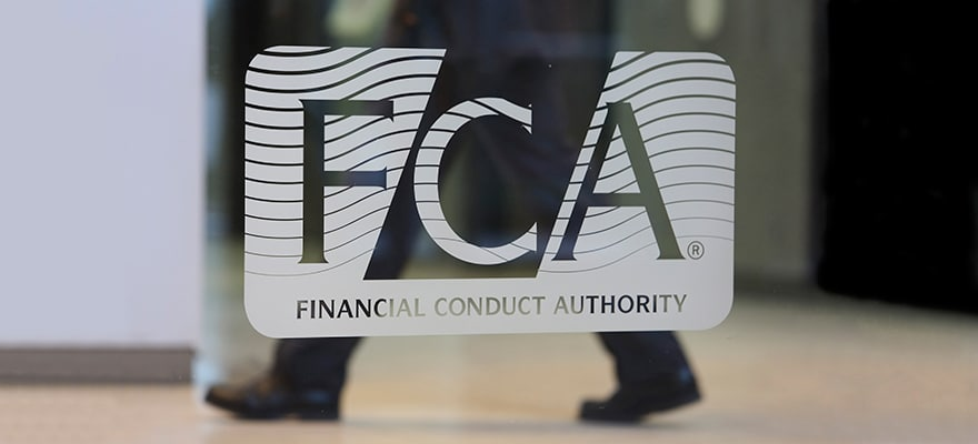 Britain's Financial Conduct Authority (FCA) logo on a glass office window in one of its UK offices