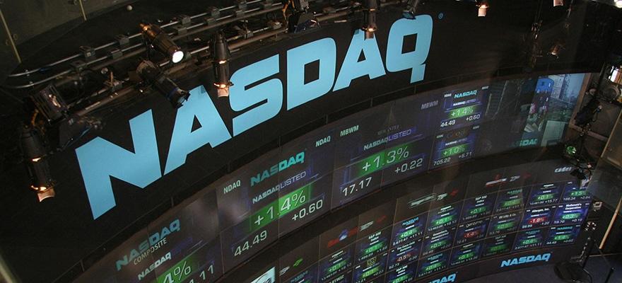 Nasdaq logo on top of a trading desk