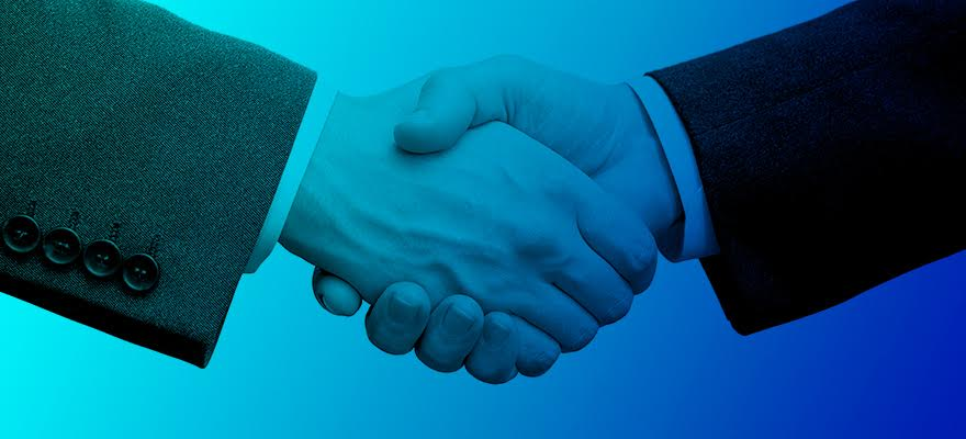 Two people shaking hands over a business partnership, Ethos