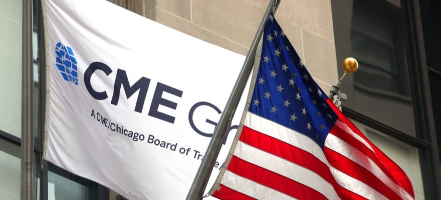 CME Group Logo on a flag behind an American flag