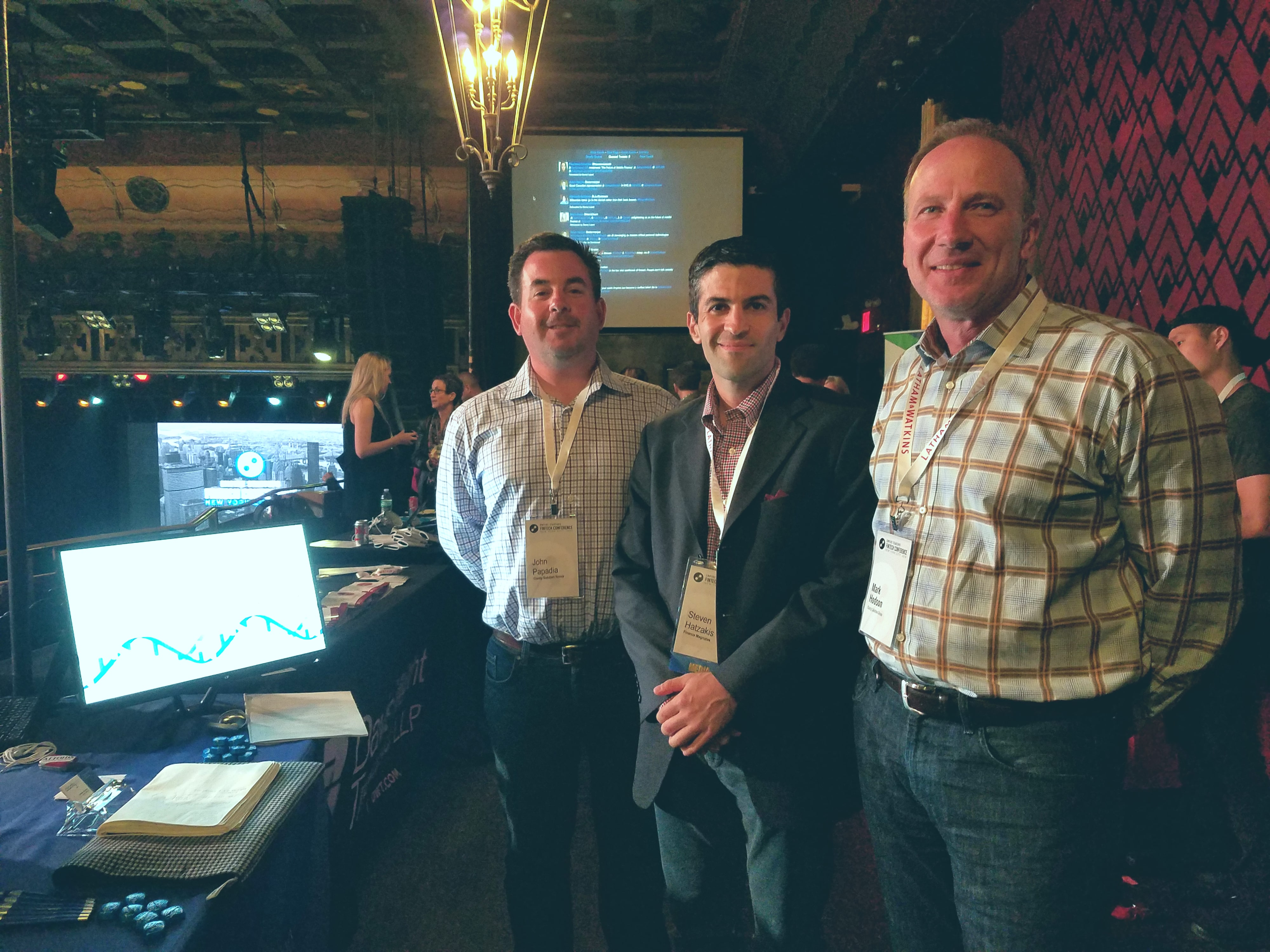 Finance Magnates' Editor Steven Hatzakis (middle) meets with John Papadia (left), President and Founder of Clarity Solutions Group, and Mark Hodson (right), Vice President of Clarity Solutions Group at the company's exhibitor booth at the Empire Startups Fintech NY conference April 28, 2016.