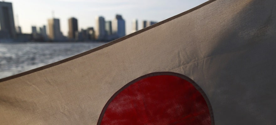 Japan flag against the skyline of Tokyo