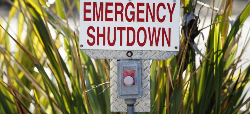 A picture displaying an emergency shut down sign