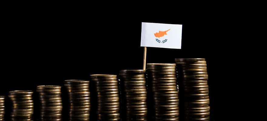 The flag if Cyprus behind stacks of coins