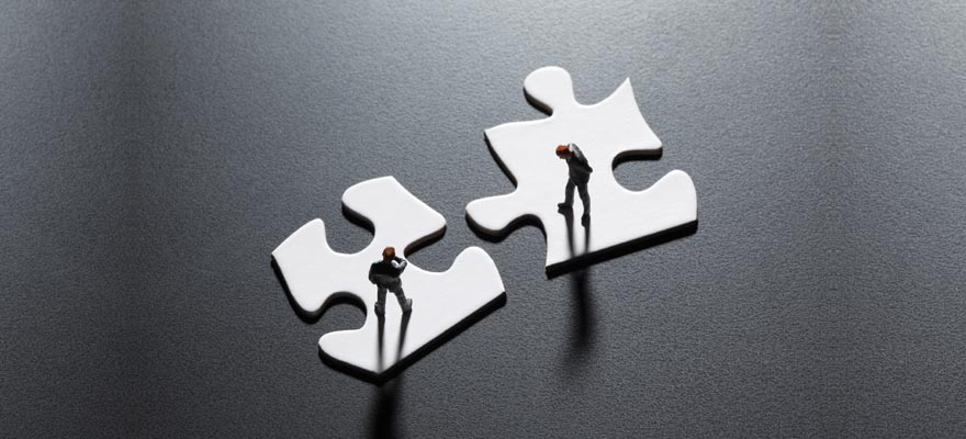 Two puzzle pieces representing a merger and/or acquisition