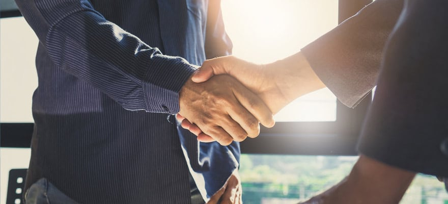 Two people shaking hands in an agreement or partnership