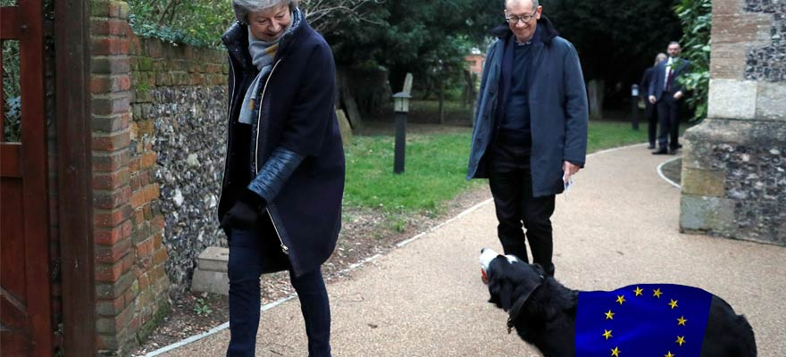 A picture of Theresa May and the EU's regulatory dog