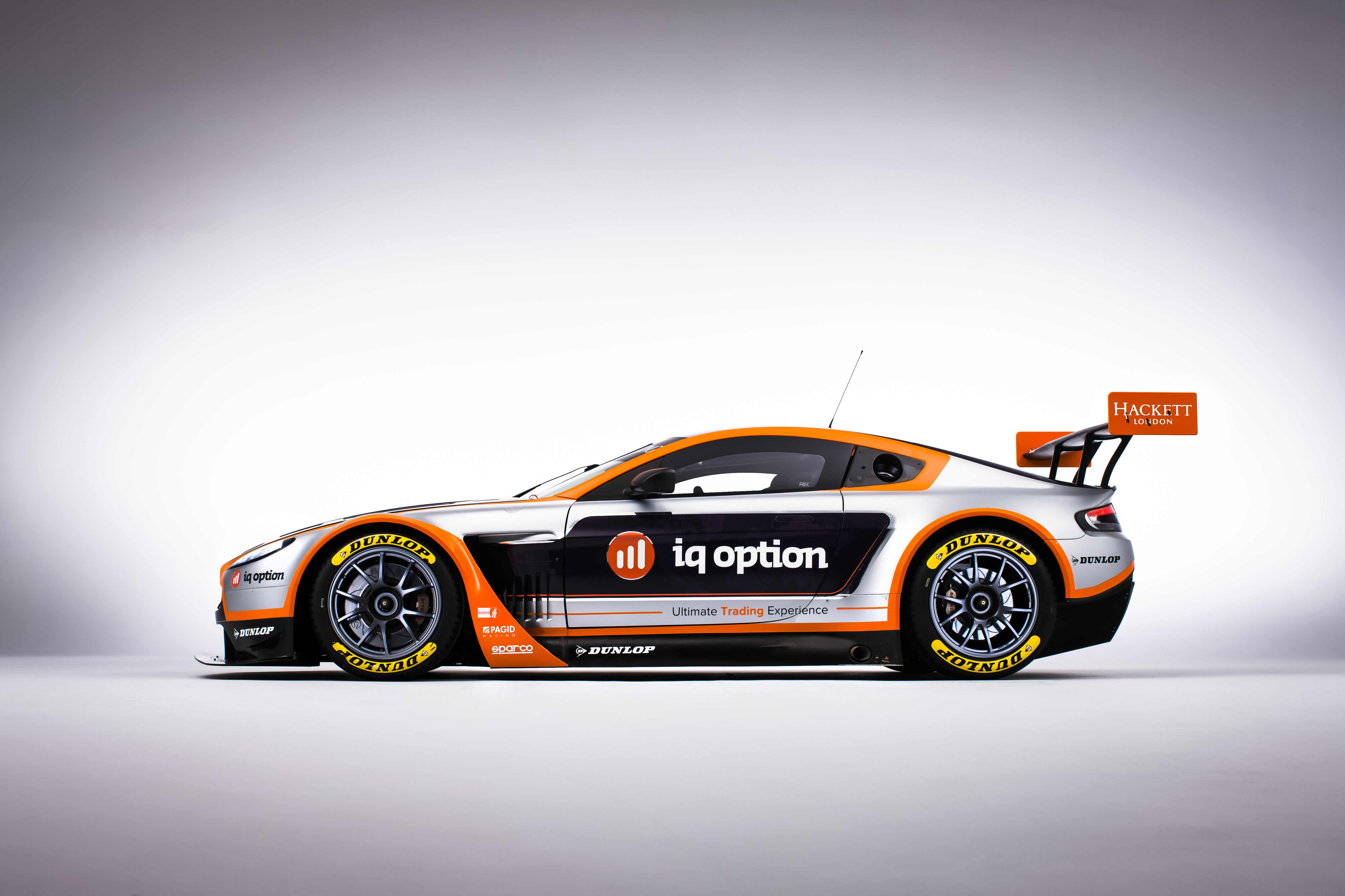 IQ Option Goes for Speedy and Reliable with Aston Martin – Race Car Sponsorship Contract