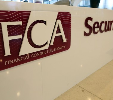 A logo sits on a sign in the reception area of the Financial Conduct Authority (FCA) in the Canary Wharf business district in London, Photo: Bloomberg