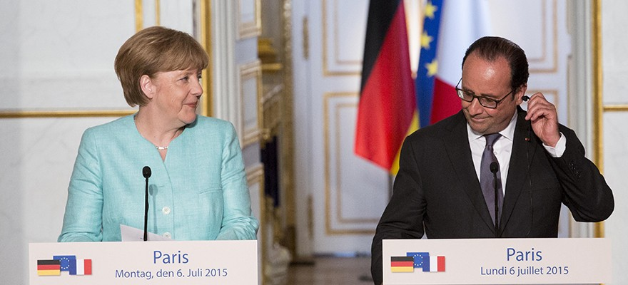 Angela Merkel, Germany's chancellor, left, and Francois Hollande, France's president, react during a joint news conference at Elysee Palace in Paris, France, on Monday, July 6, 2015. Merkel's government refused to give ground on Greek aid after Sunday's referendum went against it, saying that Greece must now present a plan on how to stay in the euro area. (Photo: Bloomberg)