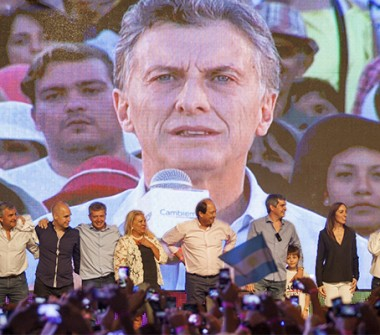 Mauricio Macri, Argentina's president-elect, is shown on a screen at his campaign headquarters in Buenos Aires, Argentina, on Sunday, Nov. 22, 2015. Sunday's election of opposition candidate Mauricio Macri marks a moment investors have been waiting for in Argentina for a long time.  (Photo: Bloomberg)